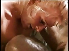 Lovely blonde slut wraps her lips around a hard black cock
