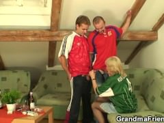 Very old blonde granny swallows two cocks