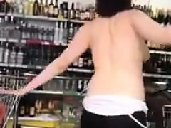 Sexy beauty doing a striptease in public