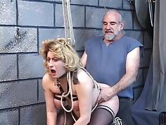 Big tit blonde gets captured by her master.